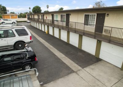 Outdoor parking and garages of Villa Del Sur apartments