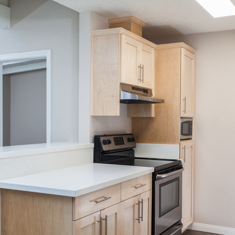 Wood kitchen cabinets and white countertop