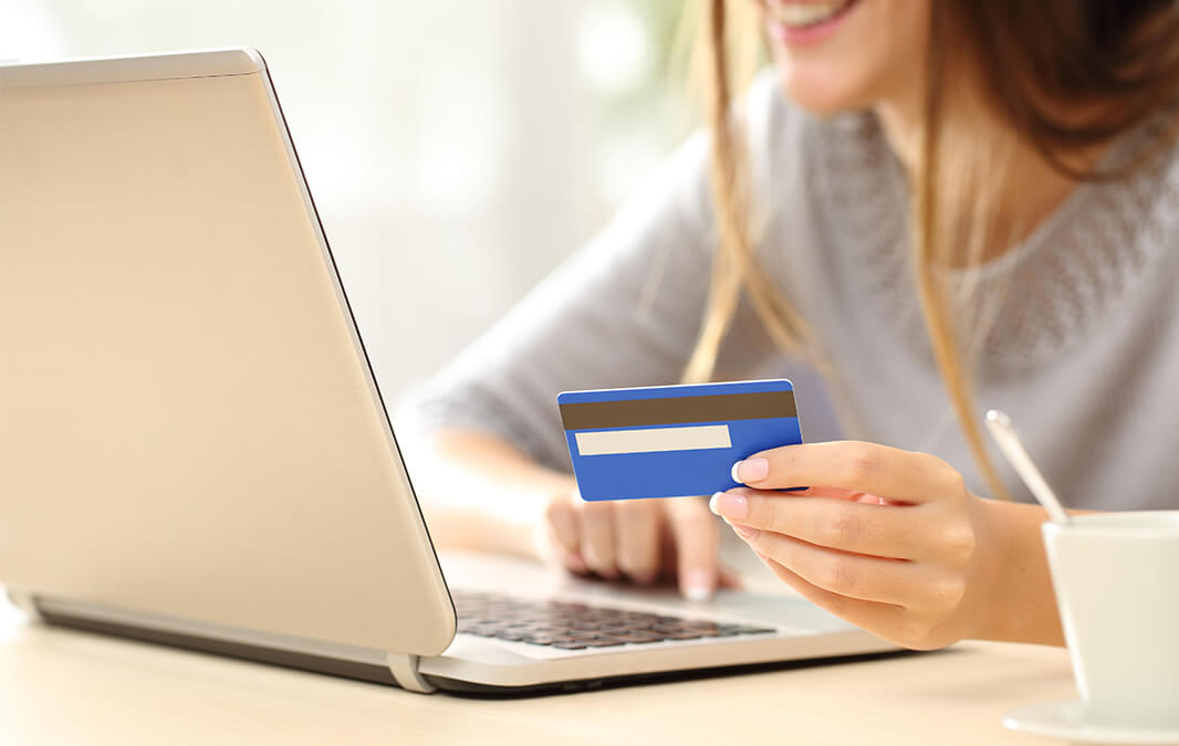 Woman holding her Credit card