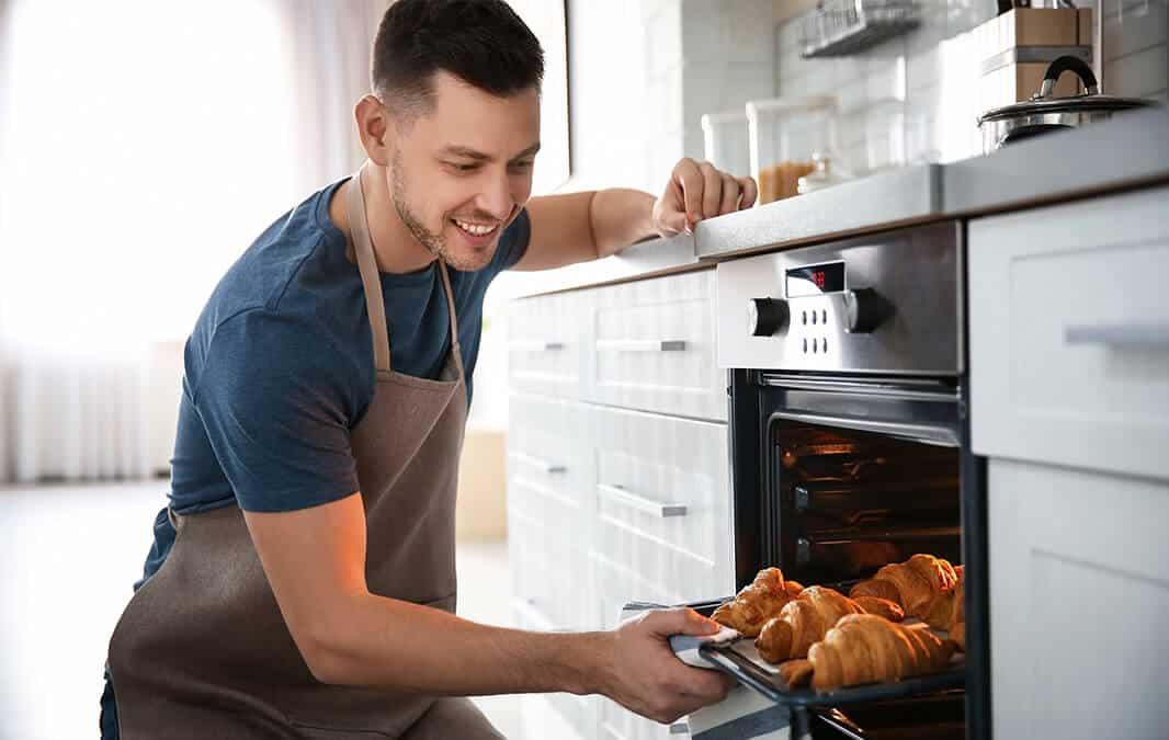 Man baking rolls
